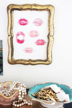 diy. kiss a paper with different color lipsticks on. outline with a fine line pen. frame.