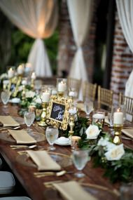 Luxury Garden Wedding in Winter Park, Florida at Casa Feliz - Style Me Pretty - Luxury Living For You Winter Park Florida, Gold Candles, Pillar Candles, Green Garland, Luxury Pools, Reception Table, Wedding Receptions, Wedding Arrangements, Luxury Living
