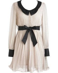 Swiss Miss Dress: Features a sharp contrast collar with keyhole closure at nape, long chiffon sleeves finished with bold black snap-closure cuffs, millions of pin-sized polka dots sprinkled throughout, and a removable faux-leather belt to finish.