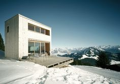 AFGH Architects designed a holiday home on the Rigi, Scheidegg in Switzerland that boasts spectacular views of the Alps.