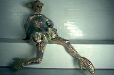 Spring Summer 2010 gold armadillo shoes on Lady Gaga. Alexander McQueen's last collection