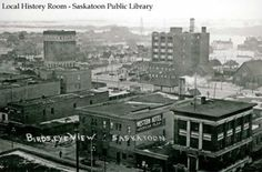 SASKATOON | Bird's-eye view of downtown | Looking northeast from above intersection of 21st Street and 2nd Avenue. In foreground is building later known as Toronto General Trusts. Western Hotel. Ross Building and Standard Trusts Building loom up in middle distance. The first Third Avenue Methodist Church on 3rd Avenue, cluster of houses on 22nd Street and St. Paul's grade school beyond, and back of Fire Hall on 23rd Street are also visible. (c. 1912) | Saskatoon Public Library ID Number…