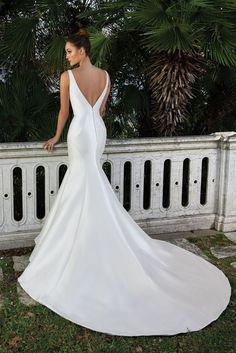 This dress embodies the clean and classic trend. This V-neck stretch Mikado fit and flare gown with detachable thin beaded belt is all you'll want for your big day.