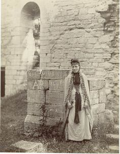 """""""Woman in one of Visby's ruins. The picture is probably from the late 1800s."""" by Carl Curman. Courtesy of the Swedish National Heritage Board (www.raa.se). (Public Domain) http://europeana.eu/portal/record/91622/D8A7AB12CD58EC3323C84608A708171F27691816.html"""