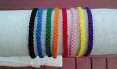 solid color friendship bracelets by Liv4Friendship on Etsy. Thin and great to stack with others!