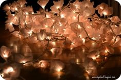 DIY: Tissue Paper Flower String Lights (don't know how safe these are, but they sure are pretty)