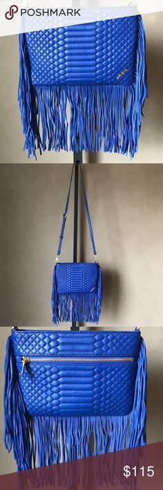"""B Brian Atwood Leather Blue Fringe Crossbody Bag Lux leather crossbody designed in a quilted snake pattern with fringe trim Crossbody strap, 23"""" drop Top zip closure Inside zip pocket Inside slip pocket Two inside credit card slots Outside zip pocket Lined Includes dust bag Leather 9.25"""" W x 6.5""""H x 0.5""""D B Brian Atwood Bags Crossbody Bags"""