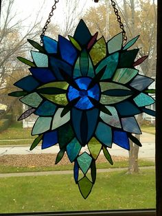 Stained glass sculpture by Damselfly Studios. Kelly Sakacs, artist.