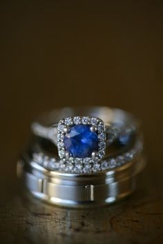 A stack of sapphire and diamond wedding rings.