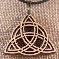 Handcrafted Laser Cut Celtic Triquetra Pendant by WoodenOddities