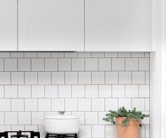 This budget-friendly, Scandinavian style kitchen features timber detailing and V-groove panelling in soft grey to bring texture and visual warmth to the space, while a white tiles and benchtop keep it light and bright. Scandinavian Interior Design, Scandinavian Style, Simple Kitchen Design, Splashback Tiles, White Cupboards, Scandi Style, White Tiles, Kitchen Styling, Wood Turning