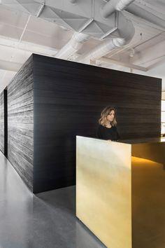 Nicole Hollis creates blackened wood library for its San Francisco studio