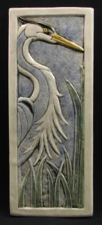 Heron tile available through Arts and Craftsman web site, but unclear who artist is