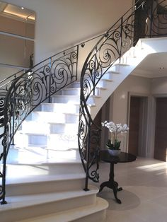 Sweeping main staircase supplied and installed in private residence Jesmond, Newcastle fabricated in Silestone Zues Extreme