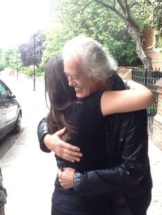 Jimmy Page with a fan outside his home in London, Aug. 12, 2014