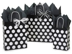 Nashville Wraps Black Polka Dots Paper Shopping Bag Assortment is made from 100% recycled white kraft paper. Green Way® Eco-Friendly Packaging.