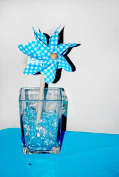 boy christening baptism party pinwheel centerpiece maybe with blue sugar on the bottom instead of crystals? or alternating white sugar?