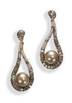 De Grisogono High Jewellery earrings in pink gold, set with brown and white diamonds and brown pearls (£POA).