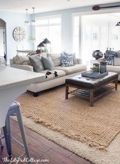 Layered Rugs for our family room. The sisal is from Pottery Barn. | The