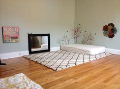 Floor bed; mirror for gross motor play