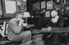 Franciscan monk Brother Isidore Corwin (R) praying with parishoner at her home as representitive of St. Francis Renewal Center.