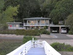 Visit LAKEHOUSEVACATIONS.com to book this home for your next lake vacation to Clearlake Oaks, CA. 2 Bedrooms. Sleeps 6. For Rent Daily $140 - Wall Of Windows Views Of Lake, Pool, Dock, Fishing Pier,& Beach. The Veranda at Baldwin's Retreat is the top floor of a two story house with spectacular views of the lake from just about every window. The Veranda has two bedrooms each with a queen bed. The living room has a wall of windows with full view of the lake and Mt. Konocti, wood burning…