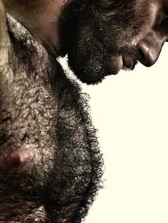 Better than a sweater to keep you warm on a chilly night: a furry, beefy, bearded, man.  (sexy men, beards, hairy men, bear, muscle-bear) Woof!