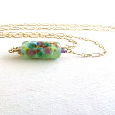 Here's a pretty from our Jetteam Jet of the Day. Very springtime looking, too.--Green Necklace Gold Filled Jewelry Lampwork Glass by LittleAppleNY, $32.00