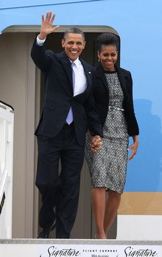 Michelle Obama and Barack Obama Photos - US President Barack Obama and  First Lady Michelle Obama arrive at Dublin Airport for their visit to Ireland, on May 23, 2011 in Dublin, Ireland. U.S. President Obama is visiting Ireland for one day. He will meet with distant relatives in Moneygall and speak at a rally in central Dublin after a concert. - US President Barack Obama Visits Ireland