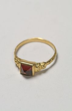 Garnet and gold ring.