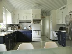 "Great idea of painting the lower cabinets a color with white painted upper cabinets! Something to think about for my kitchen white upper cabinets with gray or black ( or ?) lower cabinets, this would also look good  with the same painted faux white marble counter tops she had done earlier. Ben Moore ""Old Navy"" for the lowers and ""Woodlawn Blue"" (mildly obsessed with this color at the moment) for the walls and 1/4 tinted for striped ceiling  GORGEOUS SHINY THINGS: Paint Phase DONE"