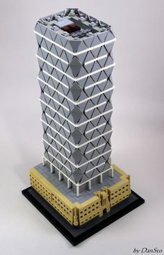 https://flic.kr/p/UGBMxo | NY Hearst Tower (AVG) | A LEGO interpretation of the New York City Hearst Tower ( www.fosterandpartners.com/projects/hearst-tower/ ) using the trianguar roadsign. The triangles of the tower being not equilateral whereas the LEGO triangles are, I had to increase the number of levels in order to keep the height over base ratio.  For details on the corners, see www.flickr.com/photos/77709542@N06/34523875111/in/album-7...