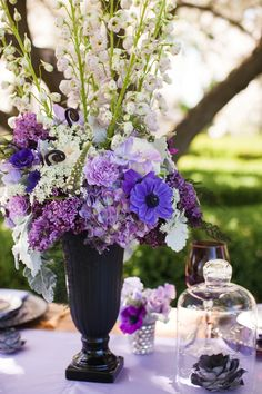purple centerpiece arrangement // photo by Ashley Biess, event design by La Belle Fleur Events http://ruffledblog.com/parisian-gothic-wedding-inspiration