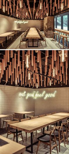 On the ceiling of this modern coffee shop, irregular timber pieces mimic the branches and hanging vines of trees. Warm light in the form of pendant lights, filters between the timber branches and mimics drops of rain falling of leaves.