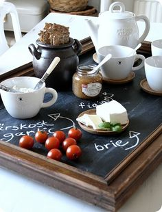Breakfast on a blackboard. This is such a cool idea! Would be kinda neat for serving charcuterie at a restaurant - then you wouldn't forget all those cheese your server rambled off.