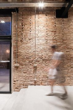 Throughout this home, elements of the old, original carpenter's workshop have been kept and highlighted, like this brick wall.