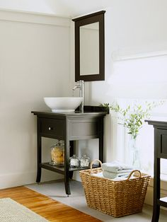 Basket Storage -  Set a large woven basket next to the sink for instant storage. Stock it with plenty of fresh, fluffy towels to add soft texture to the space.