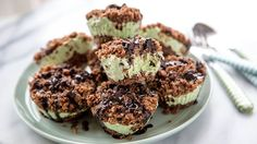 Our classic crunch cake, turned into minty green minis! These chocolate-topped, mint-kissed frozen cupcakes are perfect for ice cream obsessives.