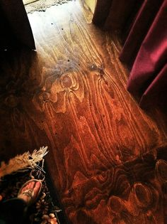 This floor was handmade from PLYWOOD! The lady hand drew the lines, screwed it in and stained it with a dark finish! Stained Plywood Floors, Outdoor Wedding Reception, Floor Finishes, How To Draw Hands, It Is Finished, Cabin, Flooring, Crafty, Dark