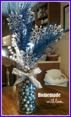 home made center pieces winter wonderland | Frost #holiday #centerpiece www.homemadewithloveweddings.com