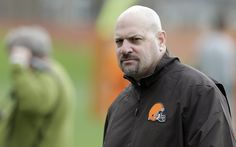 Mike Pettine speaks to the media following practice on 9/15.