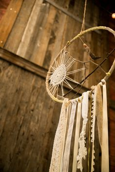 Life Size #DreamCatchers | Wedding Decor | Click thru for the wedding on http://www.StyleMePretty.com/new-york-weddings/2014/01/20/glamping-inspired-wedding-at-cedar-lakes-estate/ Tory Williams Photography