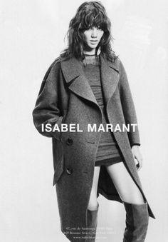 Oversized coat + mini dress + thigh high boots + chopped hair