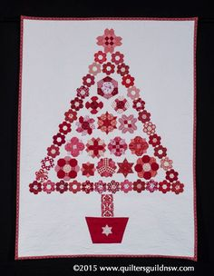 Is it Christmas Yet? by Diane Moody (Quilted by Kay Murray, Kay & Quilting).  2015 Quilters' Guild NSW show.  3rd prize, red and white, commercially quilted.