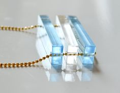 Laser Cut Acrylic Necklace - Pastel Blue and Clear Bar Beads - Long Gold Chain via Etsy