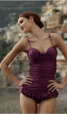 This is super cute! Retro One Piece Swimsuit - The ruching and ruffles are so retro, but the jewel toned color gives it a modern twist.