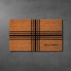 "Give your guests a warm and inviting welcome with this Plaid Coir Doormat from Hearth & Hand™ with Magnolia. Perfectly placed right in front of your door, shoes can be wiped clean before coming inside. With a black plaid pattern and the word ""Welcome"" in the corner, it brings charm to your home and seamlessly blends in with its aesthetic.<br><br>Celebrate the everyday with Hearth & Hand — created exclusively for Target in collaboration with Mag..."