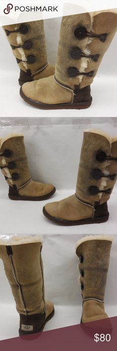 """UGG Australia Bailey Button Shearling Suede Boots Classic bailey button triplet style with tan distressed suede -these boots have been worn for a season and are still indecent condition with life left in them - Professionally cleaned -the uggs tag has been removed . - Full shearling lining Circumference 17"""" shaft height 12.5 """". Psku 287 UGG Shoes Winter & Rain Boots"""