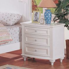 Your little girl is sure to love the jeweled hardware and carved ribbon detail of the Crystal collection. It is finished in a bright white with framed drawer fronts and turned feet that add personality to the collection. The nightstand is the perfect beside companion with 3 drawers great for stor...