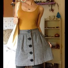 """Tweed Grey Dolly Big Button Flare Waist Skirt Super cute basic with fun Lolita like buttons. Smoke free home. Great condition. Double layers. Buttons work. Well made. Snap at top of waistband to keep it from sticking out at belly. Measurements laying flat are 13"""" waist and length total is 17.25"""" Free's Shop Skirts Mini"""